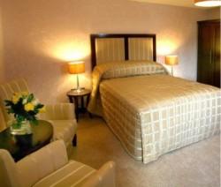 book Malone Lodge Hotel & Apartments